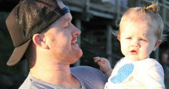 Shane Wescombe holds his daughter