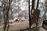 Remnants of burnt houses after bushfires burnt through Mallacoota last summer