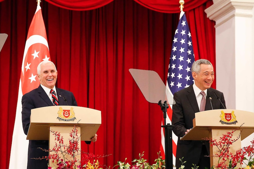 US Vice President Mike Penceand Singaporean Prime Minister Lee Hsien laugh at a joint press conference at the ASEAN Summit.