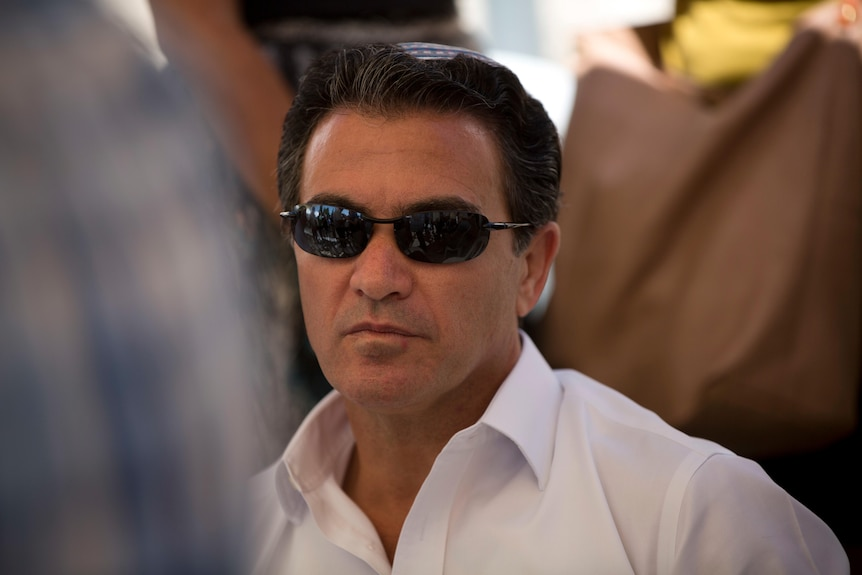 Yossi Cohen, then the director of Israel's Mossad intelligence agency, attends the funeral in Jerusalem