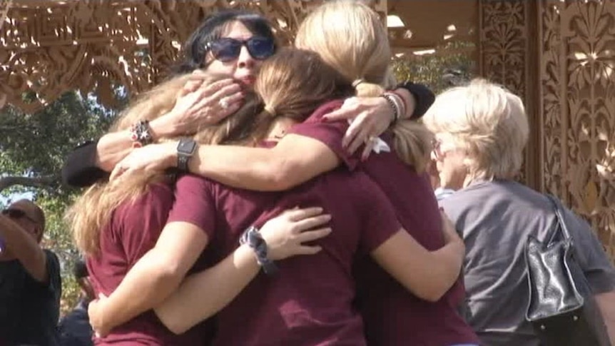 Students and parents mourn the 17 people killed one year ago at Marjory Stoneman Douglas High School