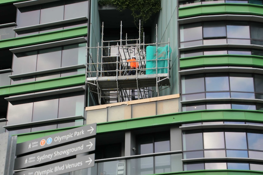 A construction worker at Opal Tower yesterday