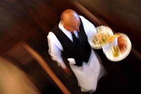 Waiter carries dishes (File image: AFP)