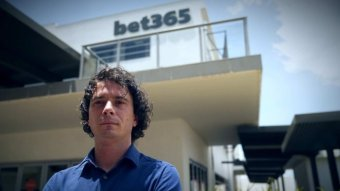 Man standing in front of bet365 buildilng.