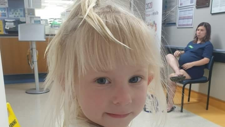 Toddler with blonde hair, dark blue eyes.