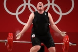 Laurel Hubbard drops weights behind her and screams.