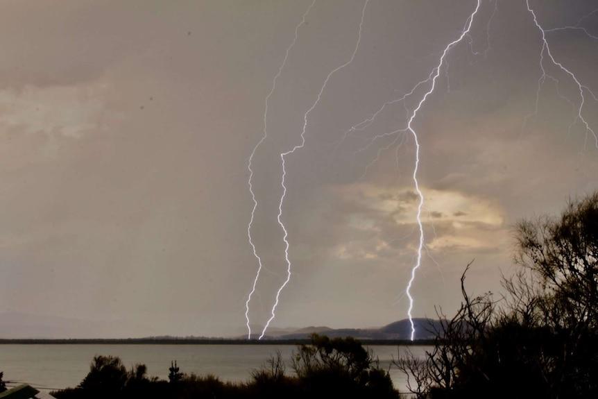 Multiple bolts of lightning strike over Tasmania's Southern Beaches.