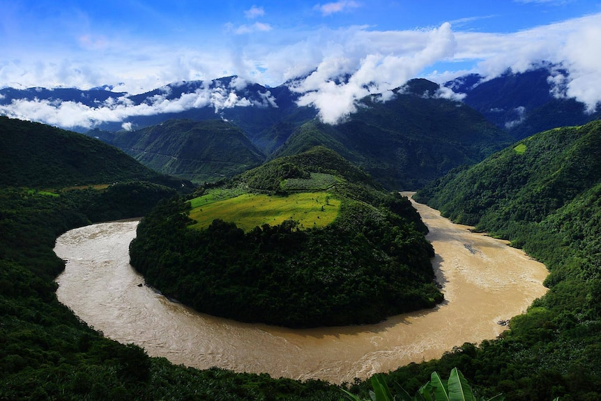 A river wraps in a sharp bend around mountain along the Yarlung Tsangpo river in Tibet