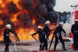 Preparing to fight flammable liquid fire at the Fiskville training facility, 1979.