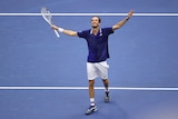 Russia's Daniil Medvedev smiles in joy and relief with his arms raised as he walks to the net after winning the US Open.