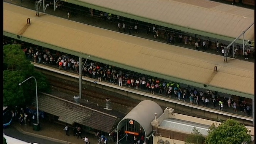 This vision, shot from a helicopter, shows commuters waiting at Strathfield station during the extensive delays.
