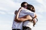 A man and woman hug