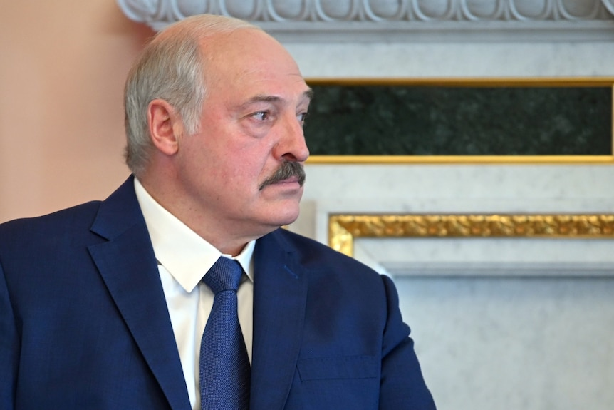 Alexander Lukashenko sits in profile at a meeting with Russian president Putin in St Petersburg