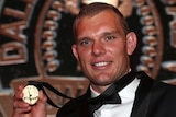 A Manly NRL players holds the Dally M Medal.