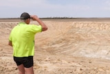 Mallee Hill farmer Noel Bairstow stands at the edge of an empty dam