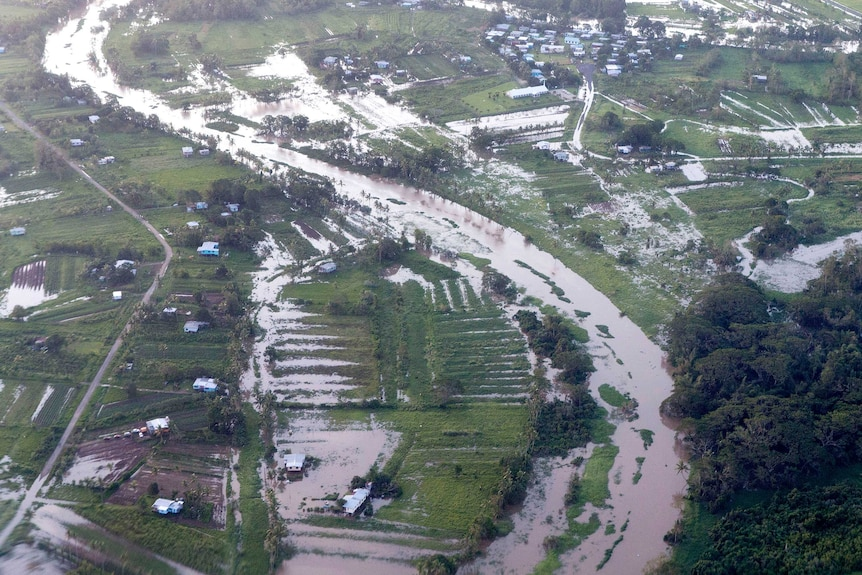 Aerial photo of widespread flooding across farmland in Fiji.