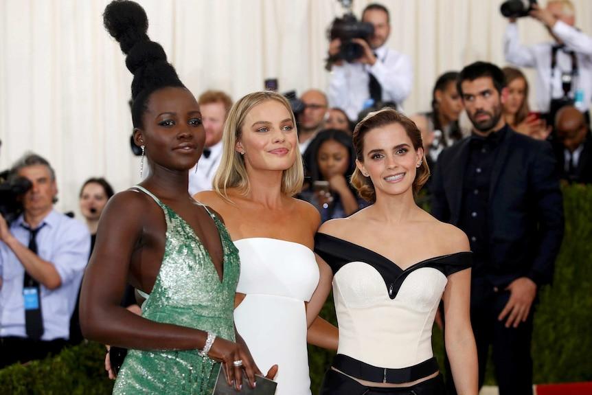 Lupita Nyong'o, Margot Robbie and Emma Watson pose on the red carpet