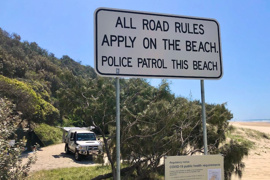 Road rules sign on sandy beach