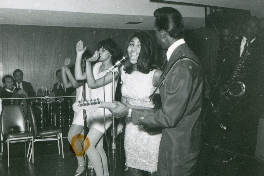 Black and white photo of Tina Turner and Ike Turner performing in 1965