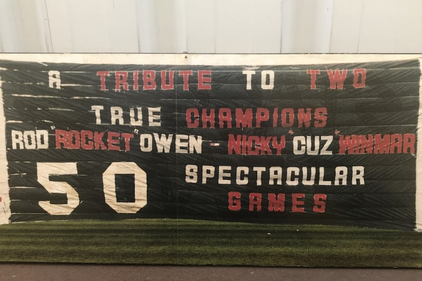 The 50th game banner made for Rod Owen in 1989 says 'a tribute to two true champions, Rod 'Rocket' Owen and Nicky 'Cuz' Winmar.