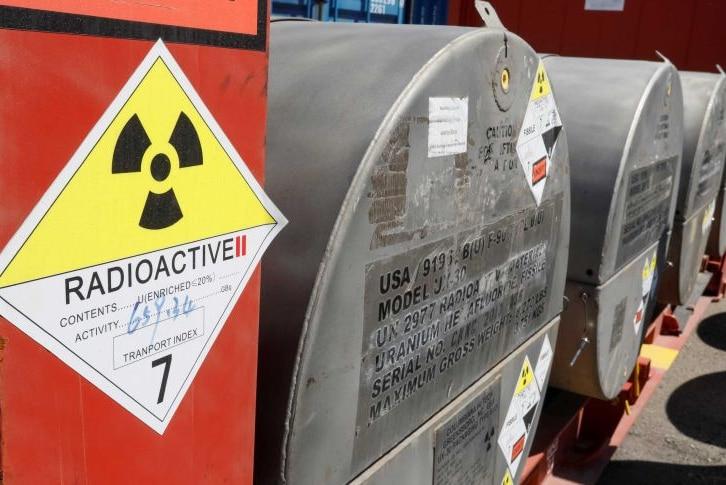Signage and metal drums containing uranium.