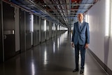 Mike Burgess in a long dark hallway.