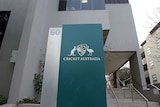 A sign next to the steps outside a city office building reads 'Cricket Australia'.