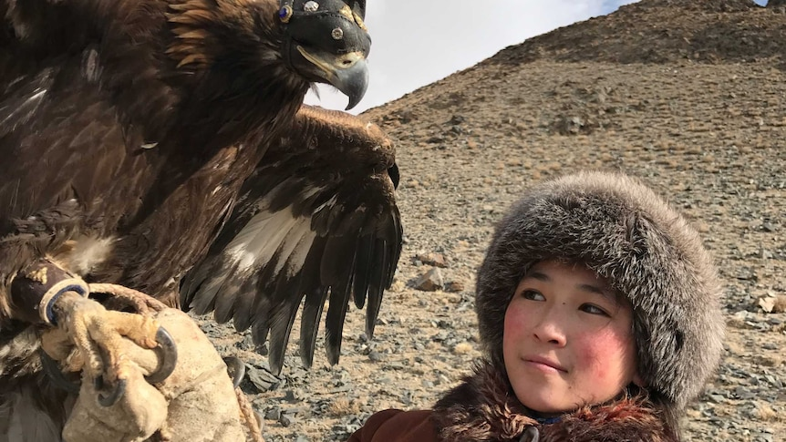 Akbota, 14, already has years of training as an eagle hunter under her belt