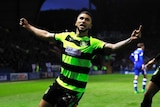 Huddersfield Town's Nahki Wells celebrates scoring their first goal with Isaiah Brown