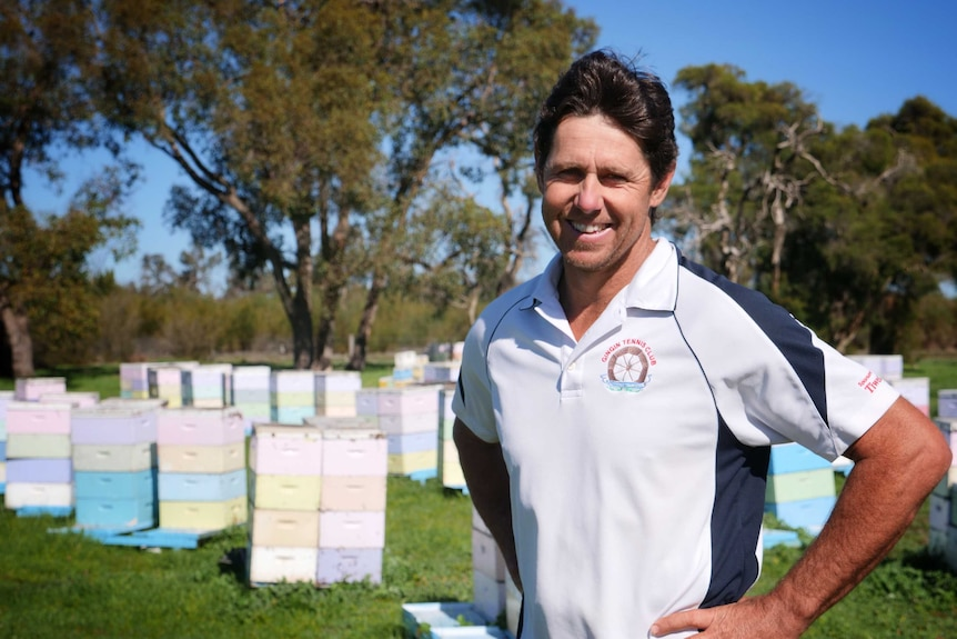 Bee Industry Council of WA chairman Brendon Fewster standing in front of hives at Muchea in July 2020.