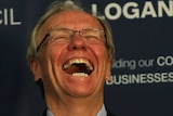 Peter Beattie laughs during a press conference to announce his 2013 election bid