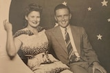 a man and woman smile at the photos