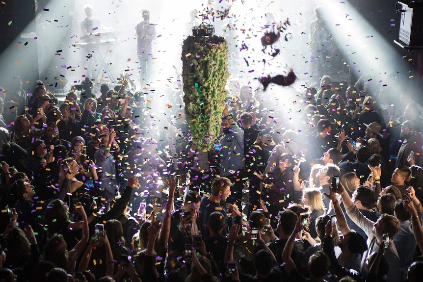 People celebrated at midnight in Toronto to mark the first day of the legalisation of cannabis.