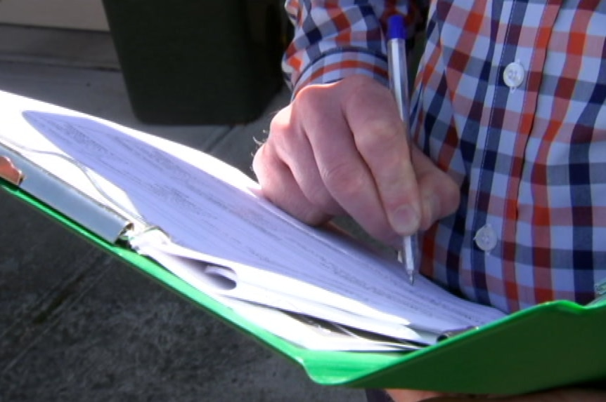 A man fills in a survey form