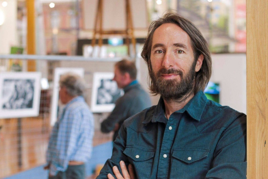 Paul Hoelen at the exhibition of his photographs Men with Heart Hobart, October 2018