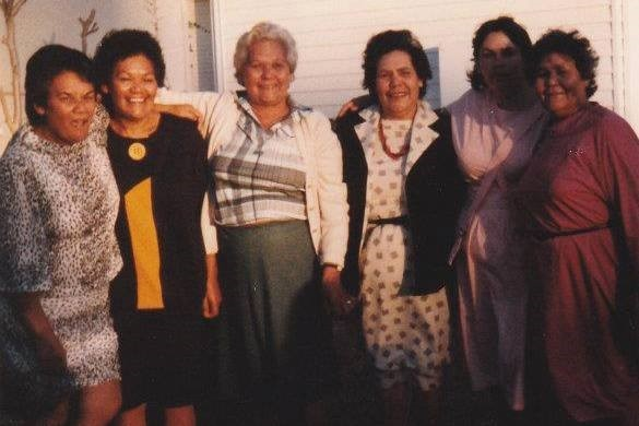 Aunty Lorraine (in black and yellow dress) and with four of her sisters and a niece.