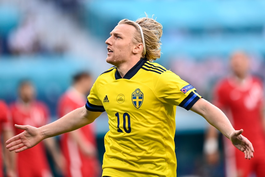 Emil Forsberg celebrates with his arms outstretched