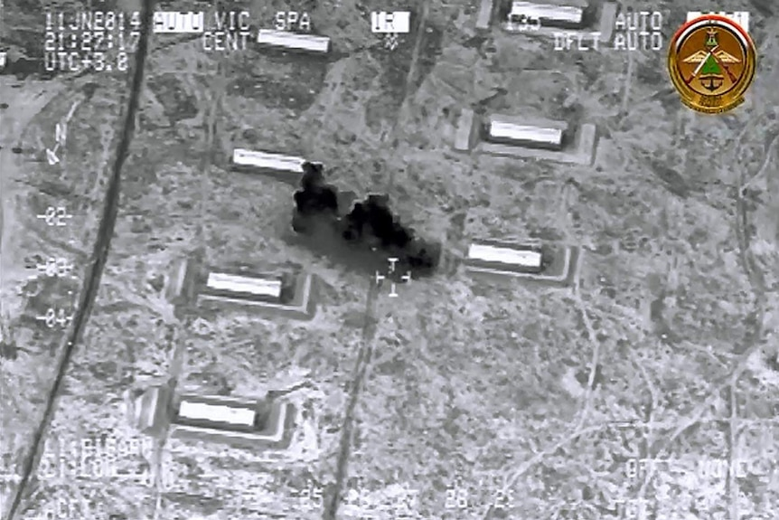 A grab from an Iraqi Ministry of Defence video reportedly shows an air strike on al-Ghazlani military camp in Mosul on June 11.