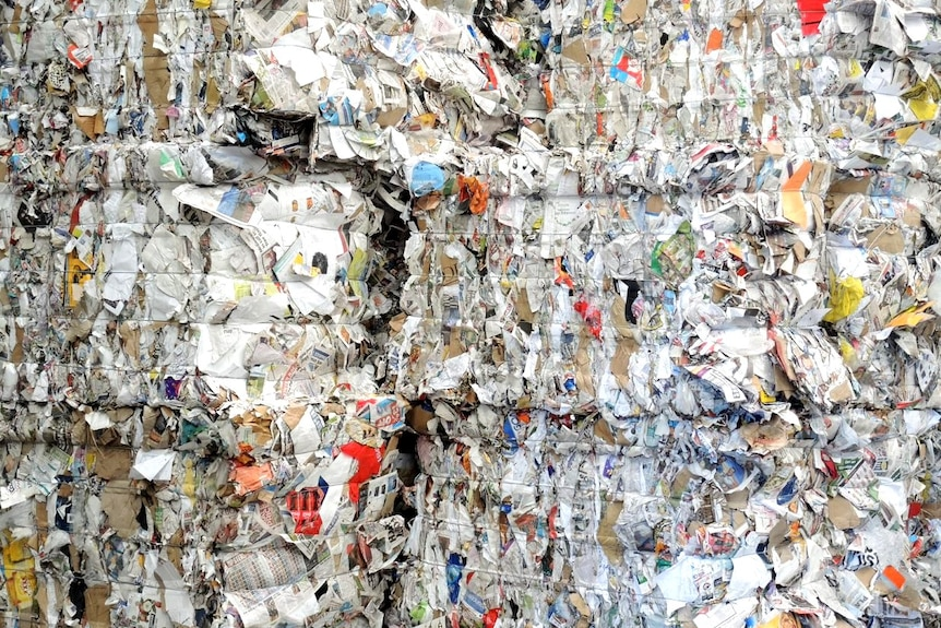 A pile of contaminated waste paper tied in bundles.