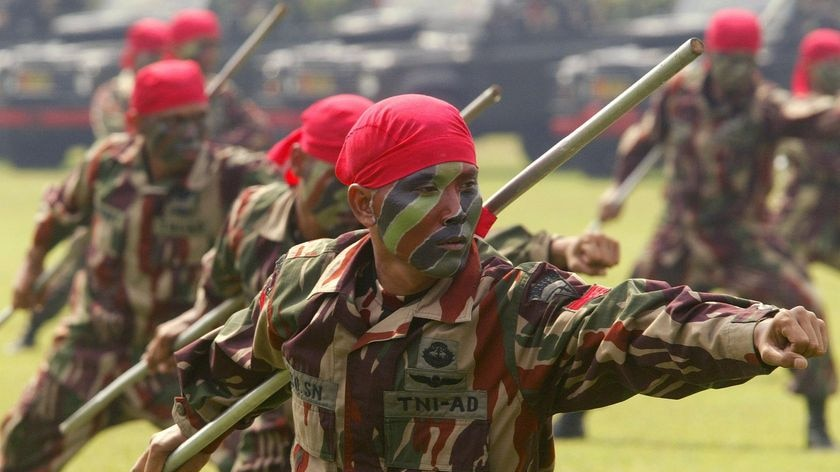 Indonesian soldiers from Kopassus special forces perform at a ceremony in Jakarta