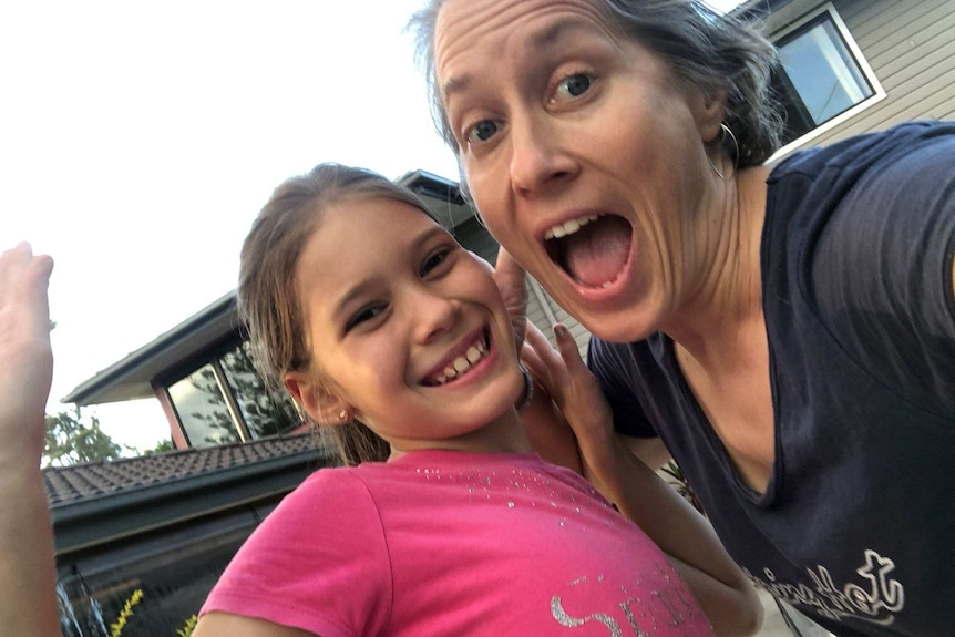 A mum and daughter take an excited selfie