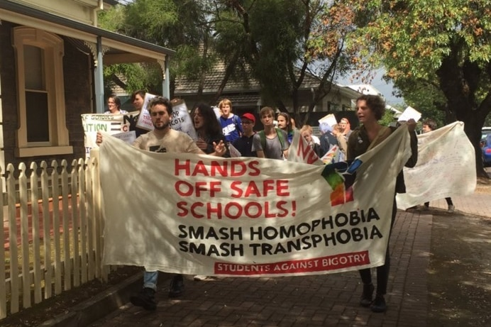 Protesters march on Cory Bernardi's office.