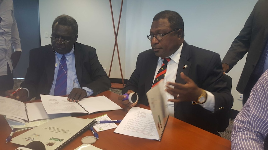 Bougainville electoral commissioner George Manu and PNG electoral commissioner Patilias Gamato.