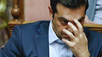 Tsipras holding head