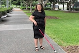 Brisbane woman Hailey Lindemann, who is blind, standing on a pathway.