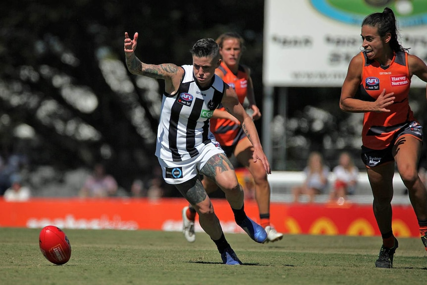 Cecilia McIntosh runs at the football during an AFLW match between Collingwood and GWS.