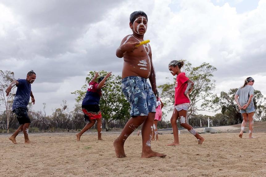 Children learn traditional dance.