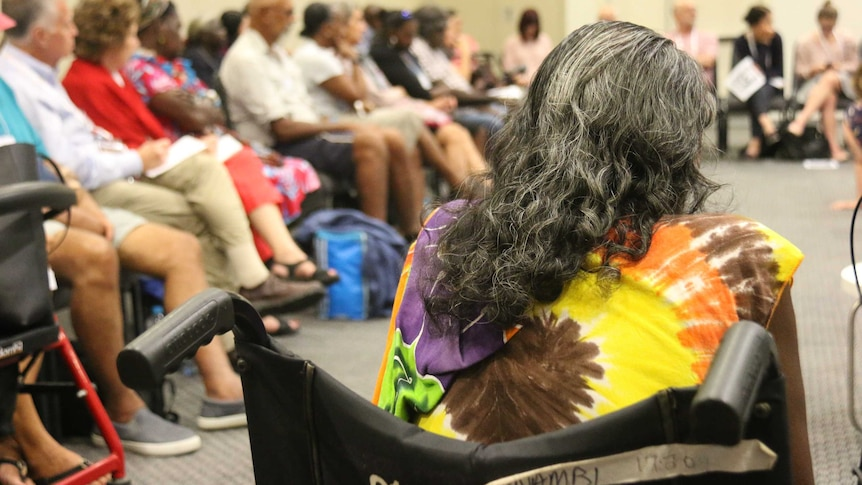 Unidentified Aboriginal woman in a wheelchair