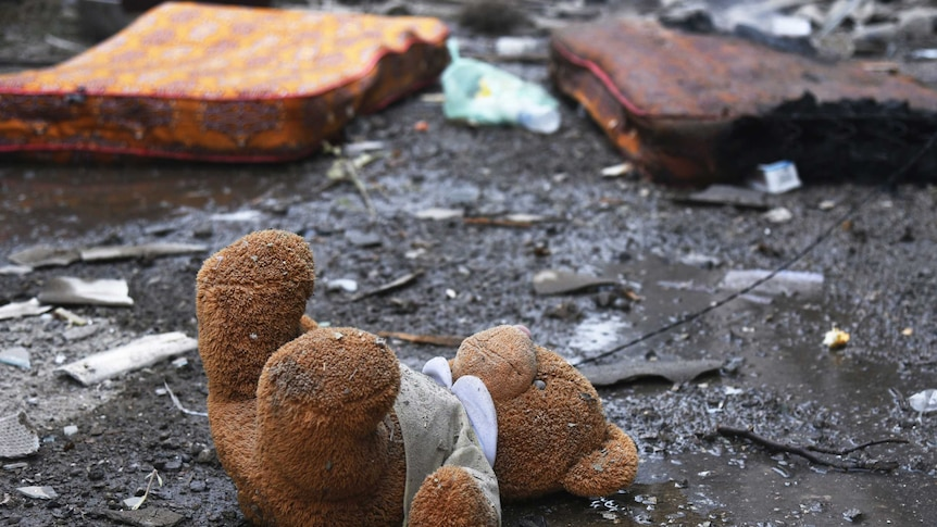 A teddy bear lies among damage in a residential area after shelling by Azerbaijan's artillery.