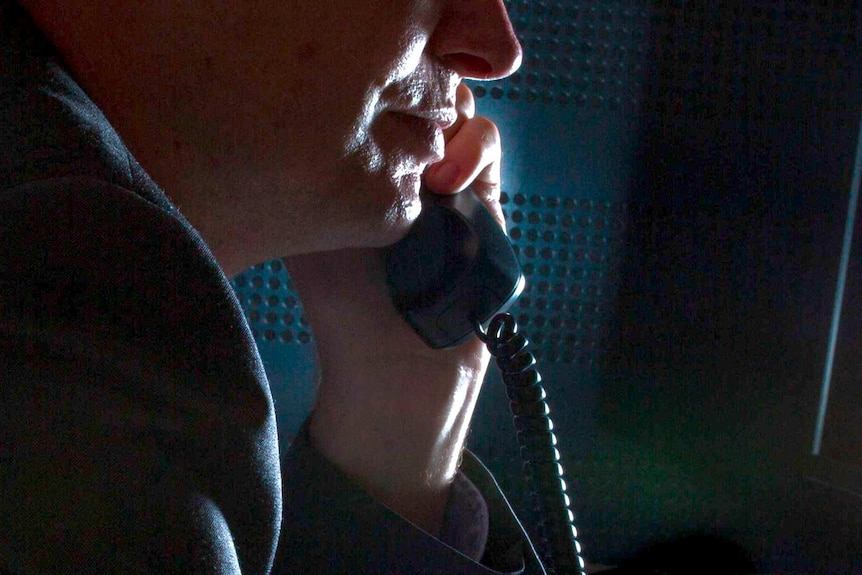 Anonymous businessman talking on the phone